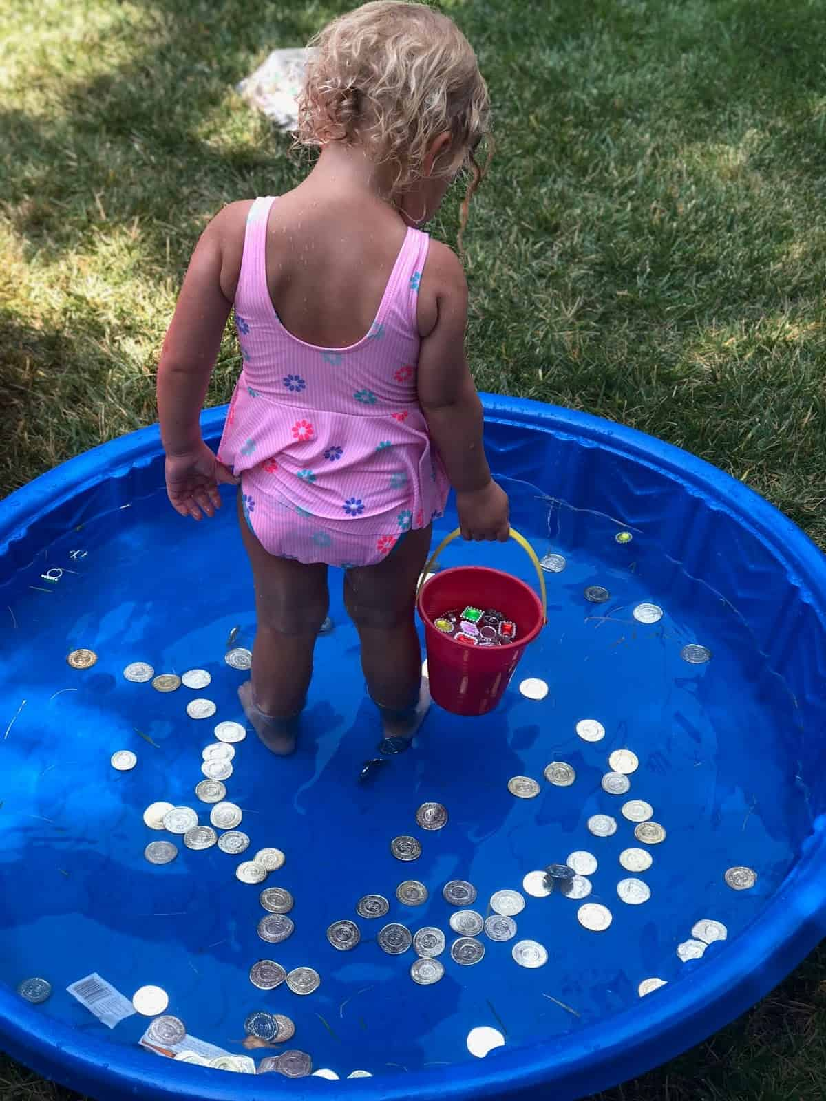 hunt for gold coins in a baby pool
