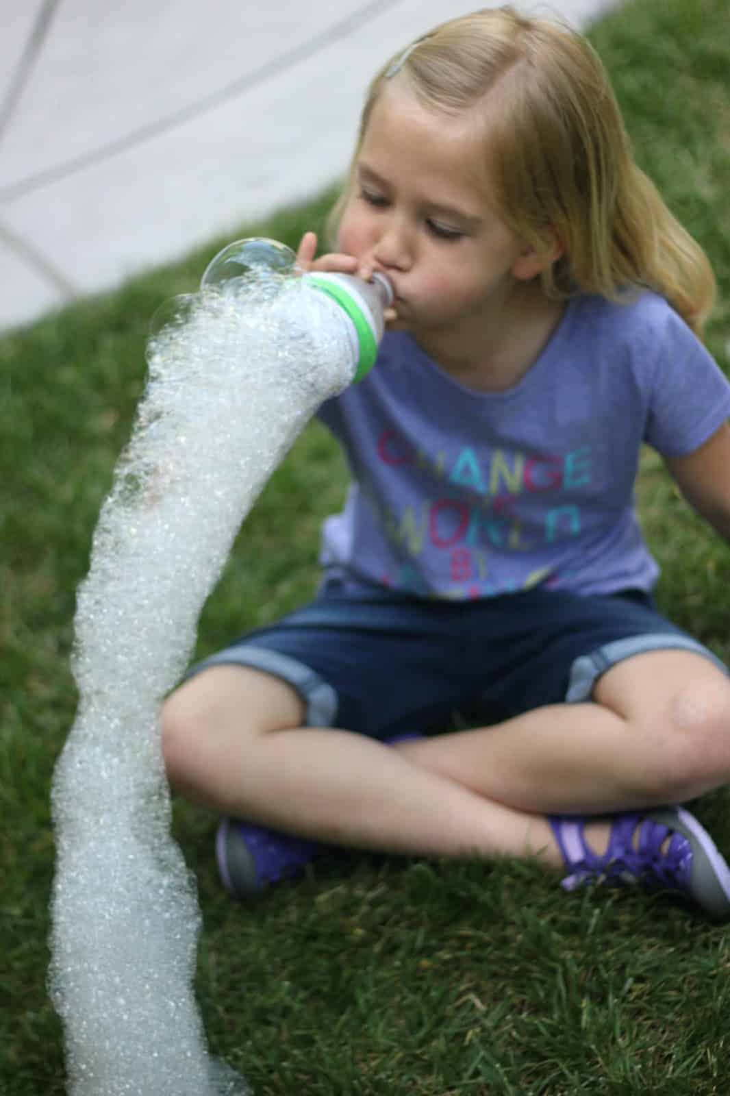 girl blowing bubble snakes