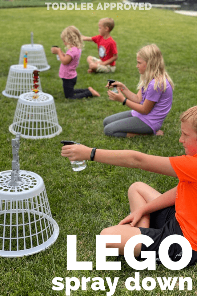four kids spraying down LEGO towers with spray bottles