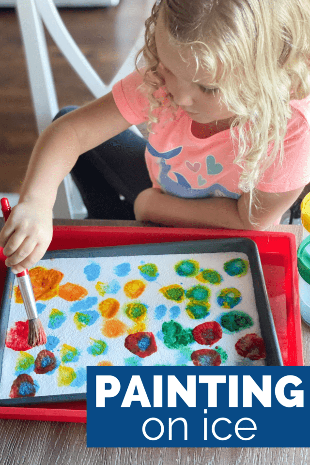 little girl painting on ice with washable paint