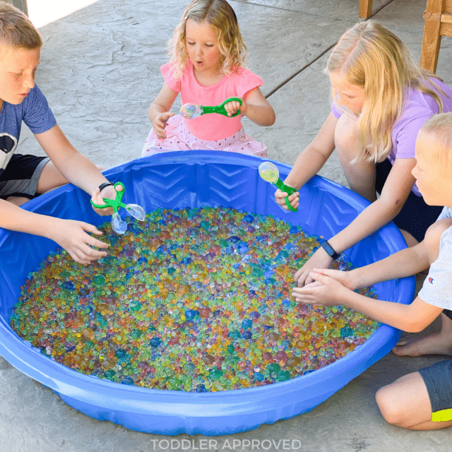 kids playing with jumbo water beads