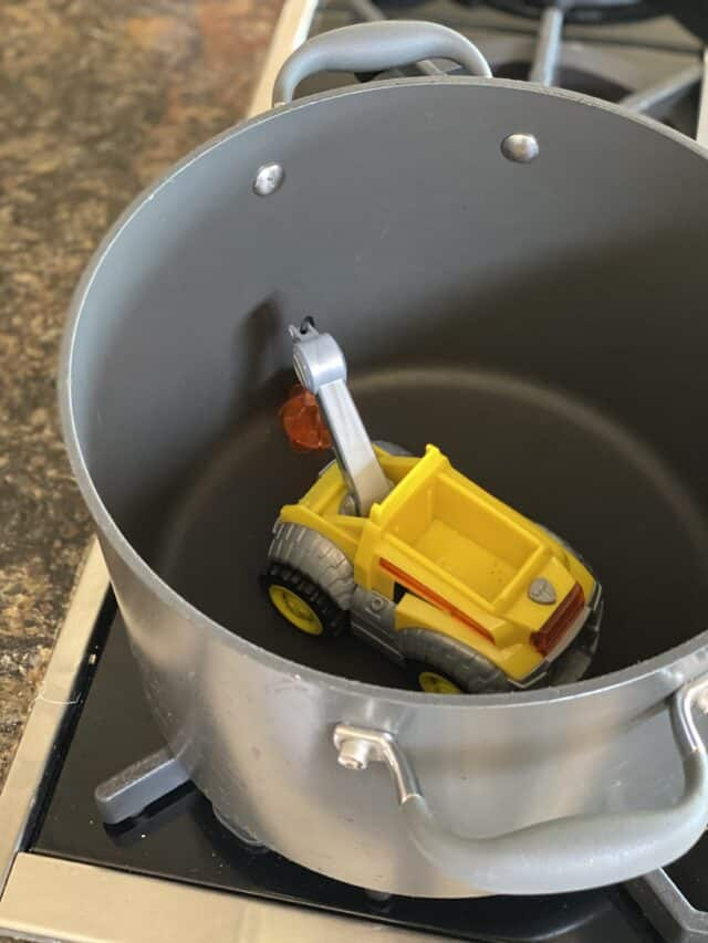 yellow Paw Patrol toy inside a kitchen pot