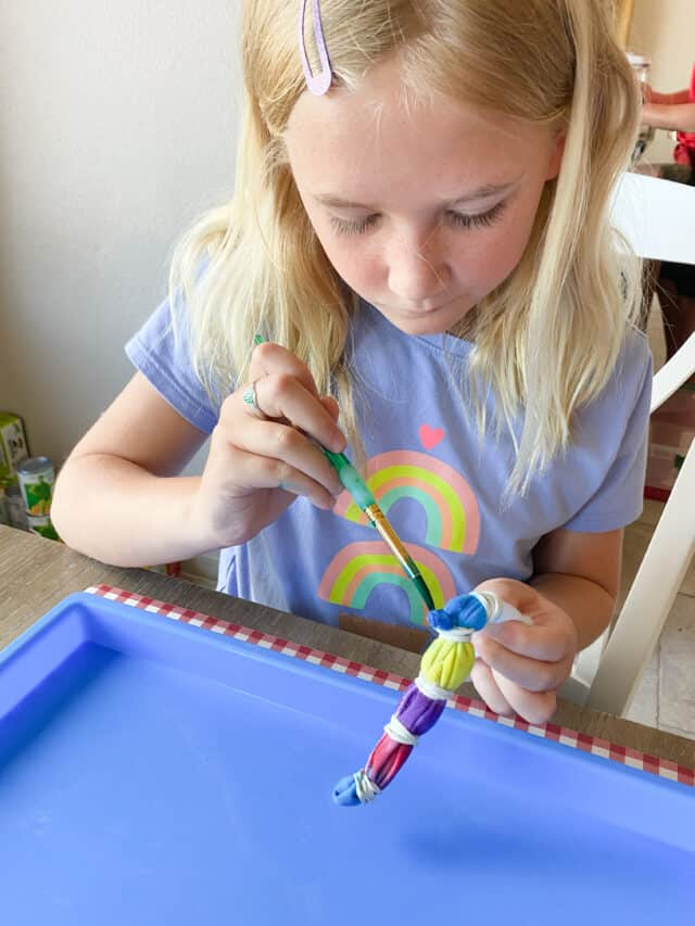 painting tie dye masks with a paintbrush