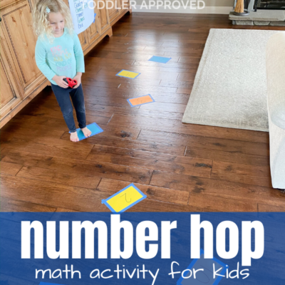 Child hopping across floor on paper numbers