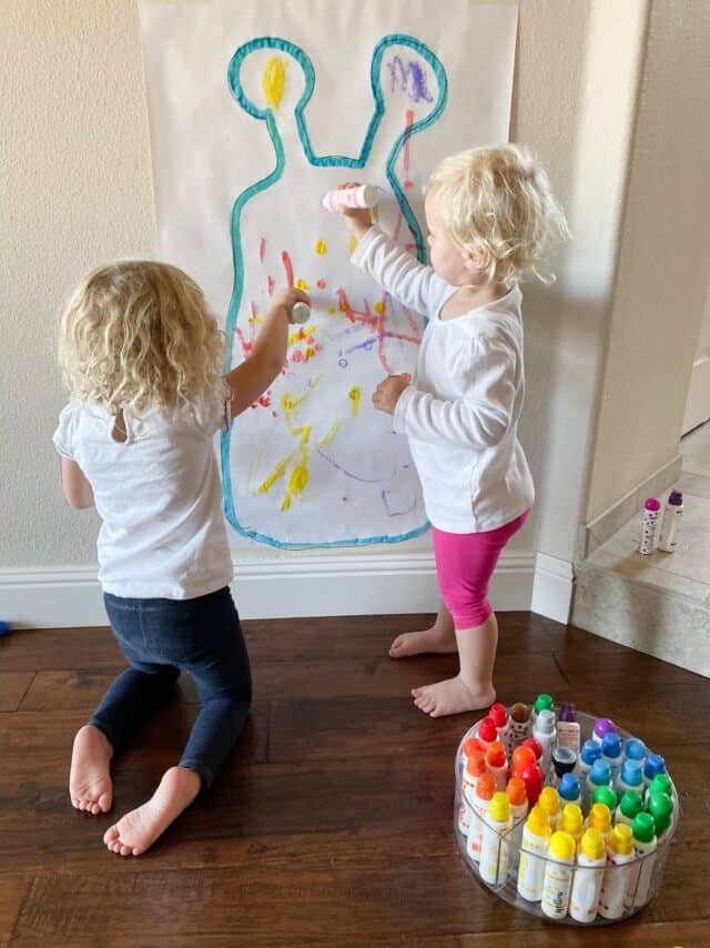 kids painting a monster with markers