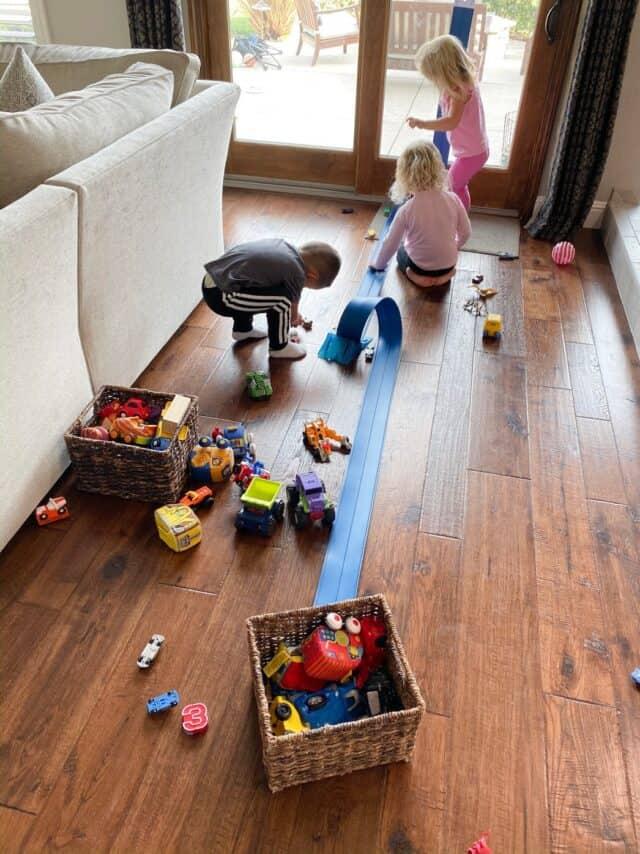 blue-trak car ramp and three kids playing