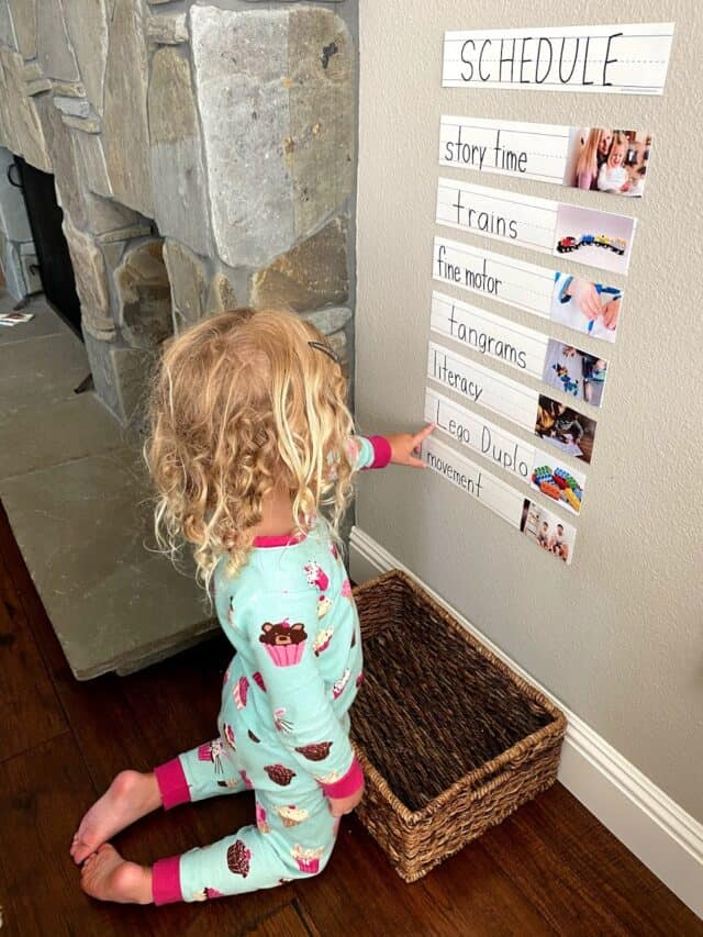 girl looking at a visual schedule