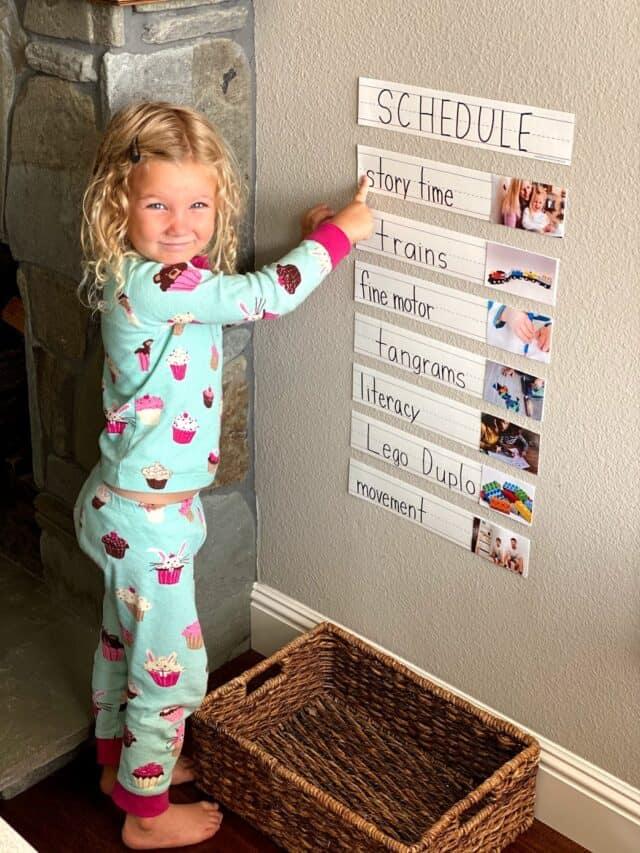 preschooler pointing at a schedule