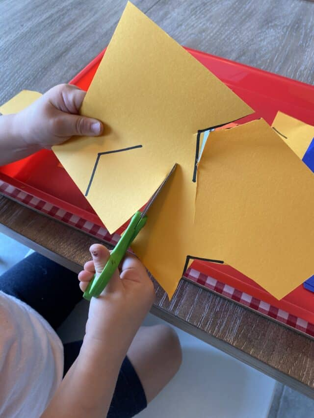 cutting zig zag lines on yellow paper