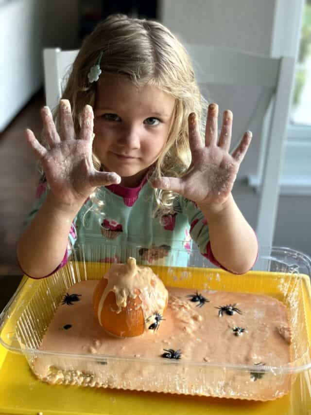 girl with messy hands covered in oobleck