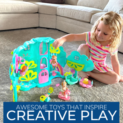 Girl playing with a Baby born Surprise™ playset.