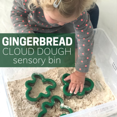 little girl playing with gingerbread cloud dough