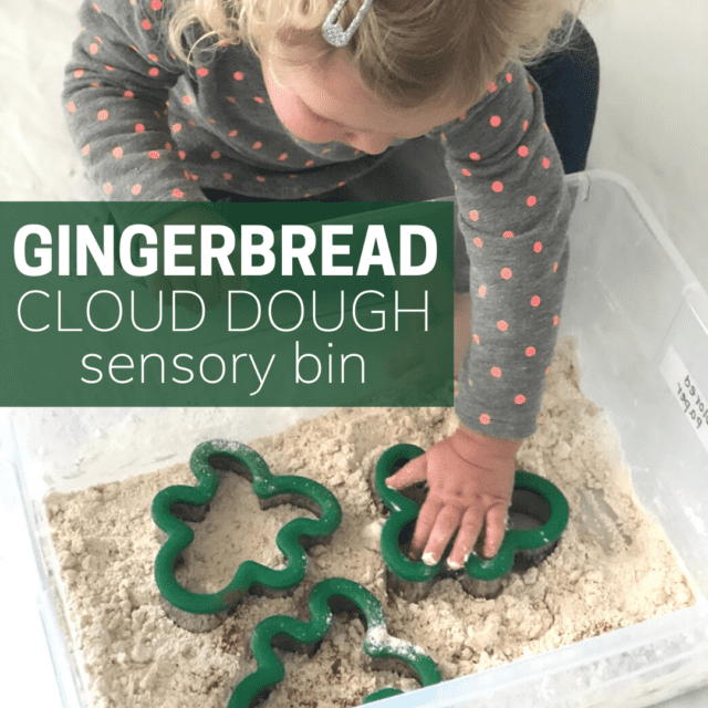 girl playing with gingerbread cloud dough in a plastic storage bin.