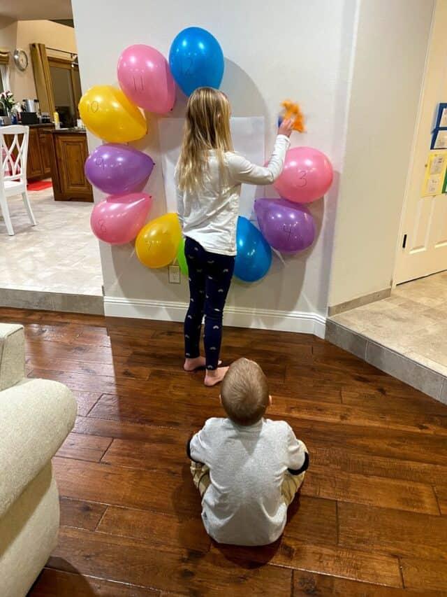 Girl popping a balloon