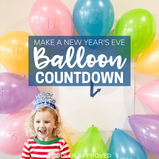 girl wearing a New Years crown standing in front of a balloon clock countdown