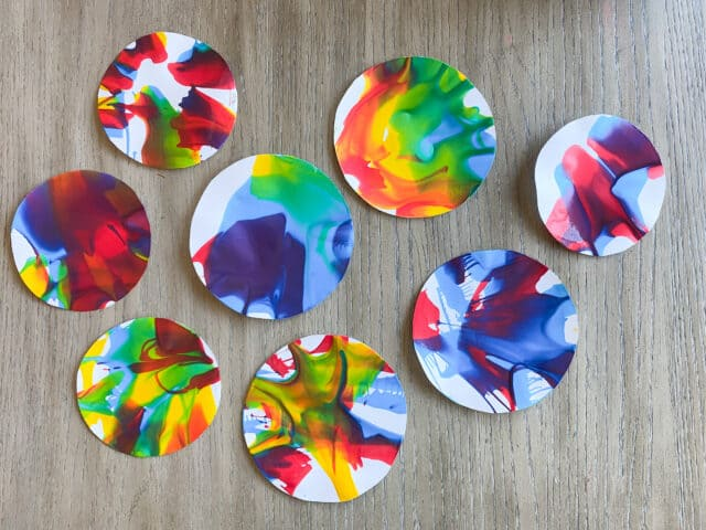 colorful circles of paper covered in paint