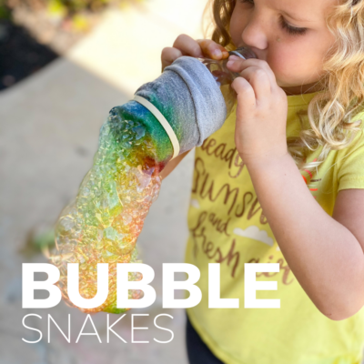 girl makes bubble snakes with a pool noodle and sock